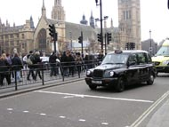 Black Cab Taxi with Houses of Parliament in the background