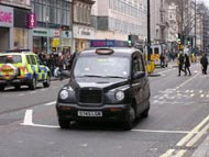 Police Car and Black Cab Taxi