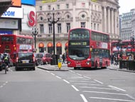 Red Double Decker Bus near Tube Station